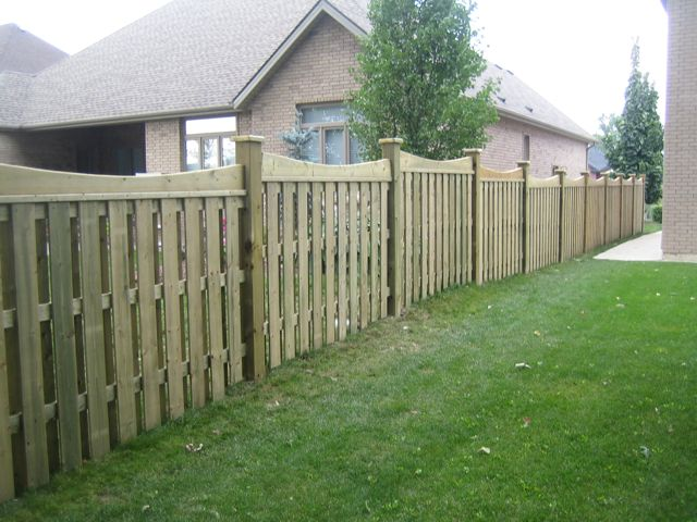 Stepped scalloped wood fence