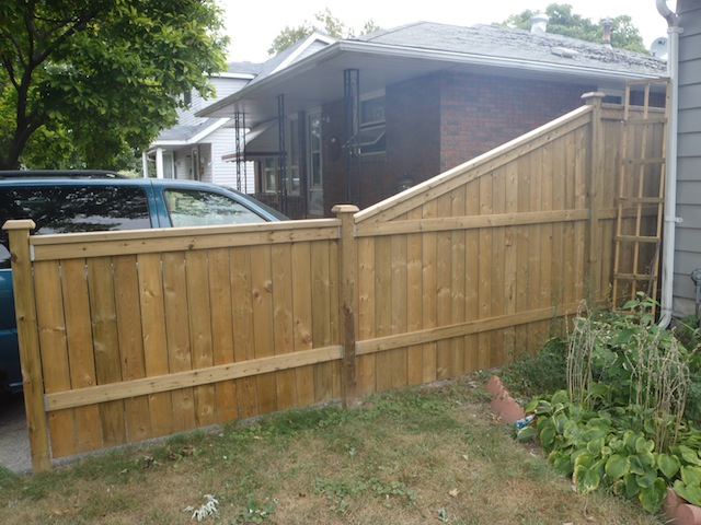 Wood fence slope