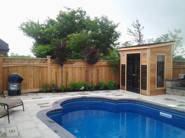 Cedar fence and shed in Lakeshore on