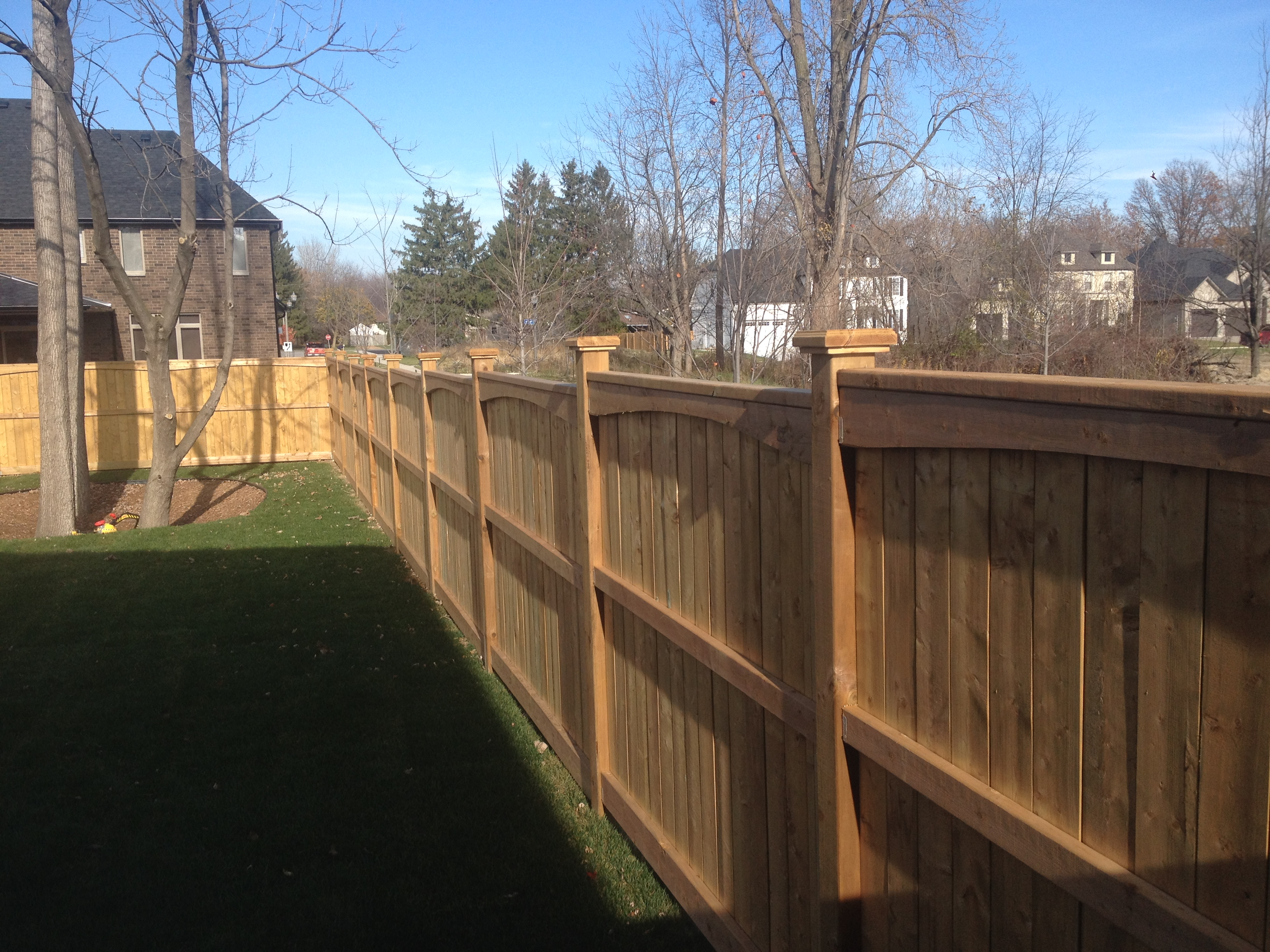 Stepped wood fence