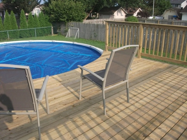 Above ground pool deck decks and fences by ryan for How to build a deck around a pool