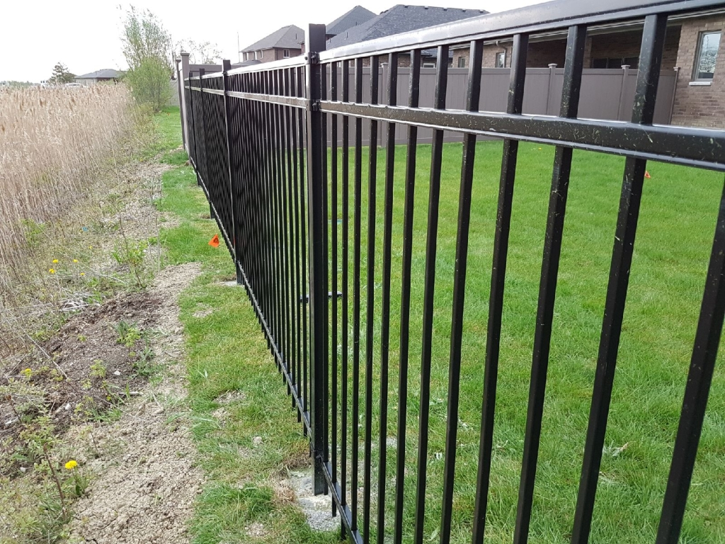 montage iron fence with bufftech vinyl fence