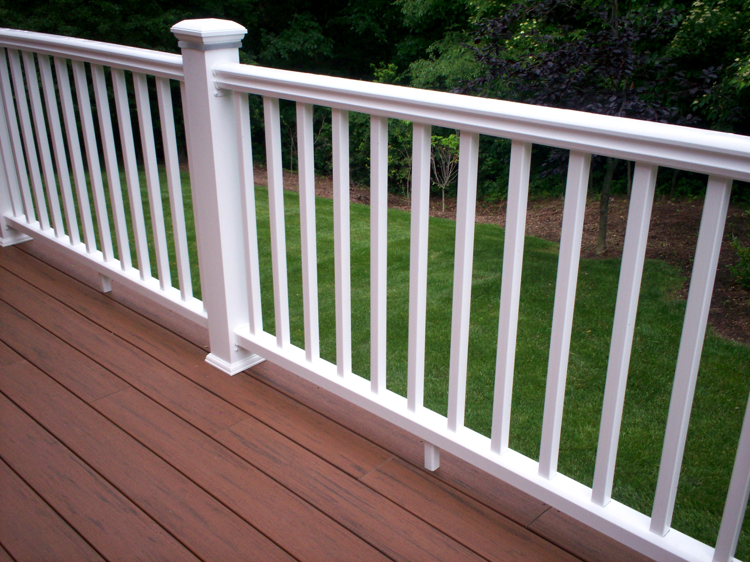 Timber tech terrain with white radiance rail railings