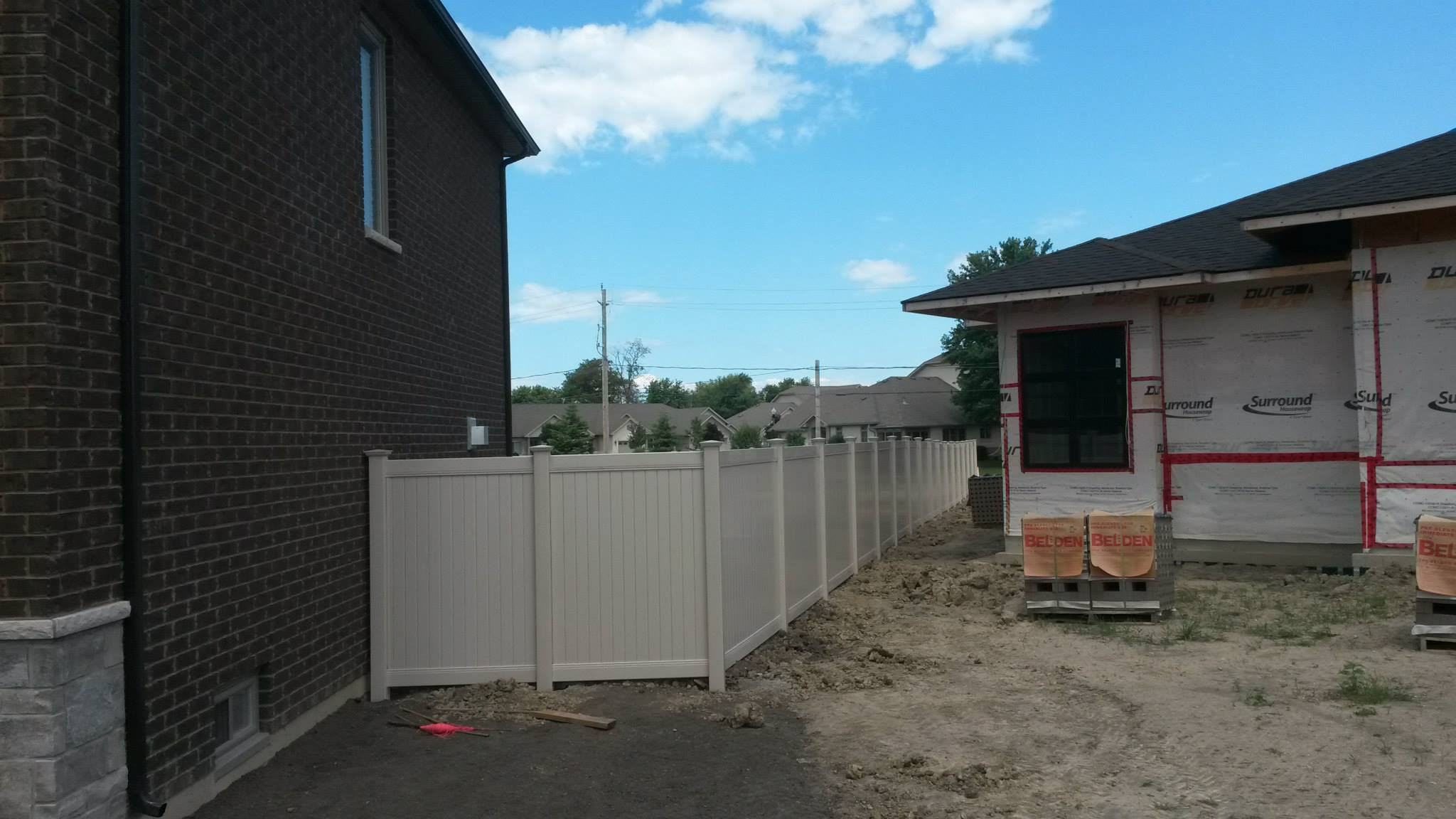 Almond vinyl fence