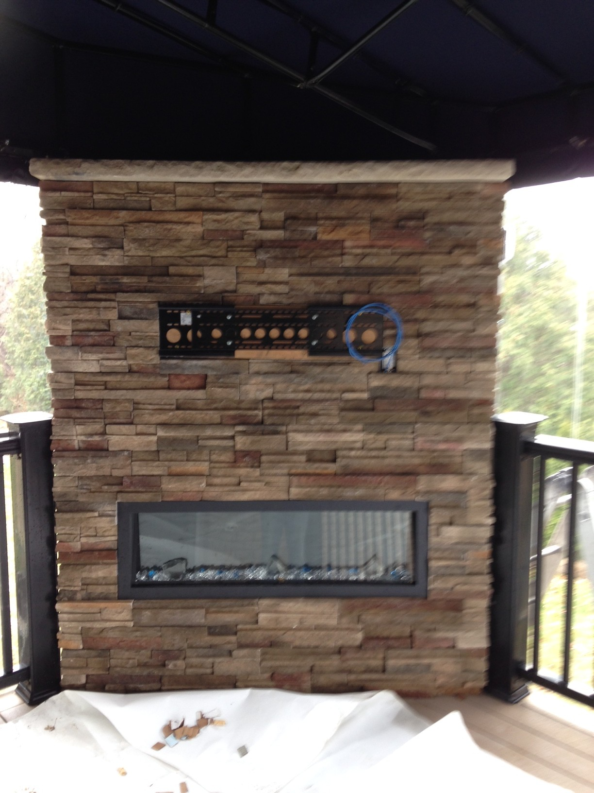 Stone accent wall with fireplace