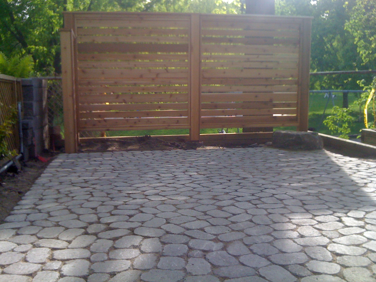 Stamped concrete vs pavers decks and fences by ryan for Landscaping rocks windsor ontario